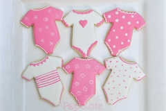 Pink onesies baby shower cookies