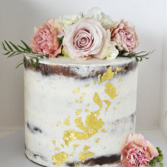 Rustic cake with gold leaf and flowers