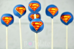 Superman logo cake pops