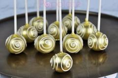 Gold cake pops with swirls