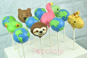 Flamingo, sloth, frog, bear, iguana, giraffe and earth cake pops